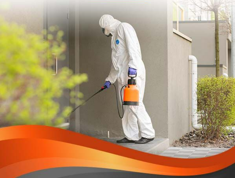 Photo of employee applying Pro-tech to a building's exterior