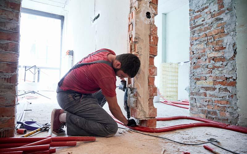 Image of man repairing walls