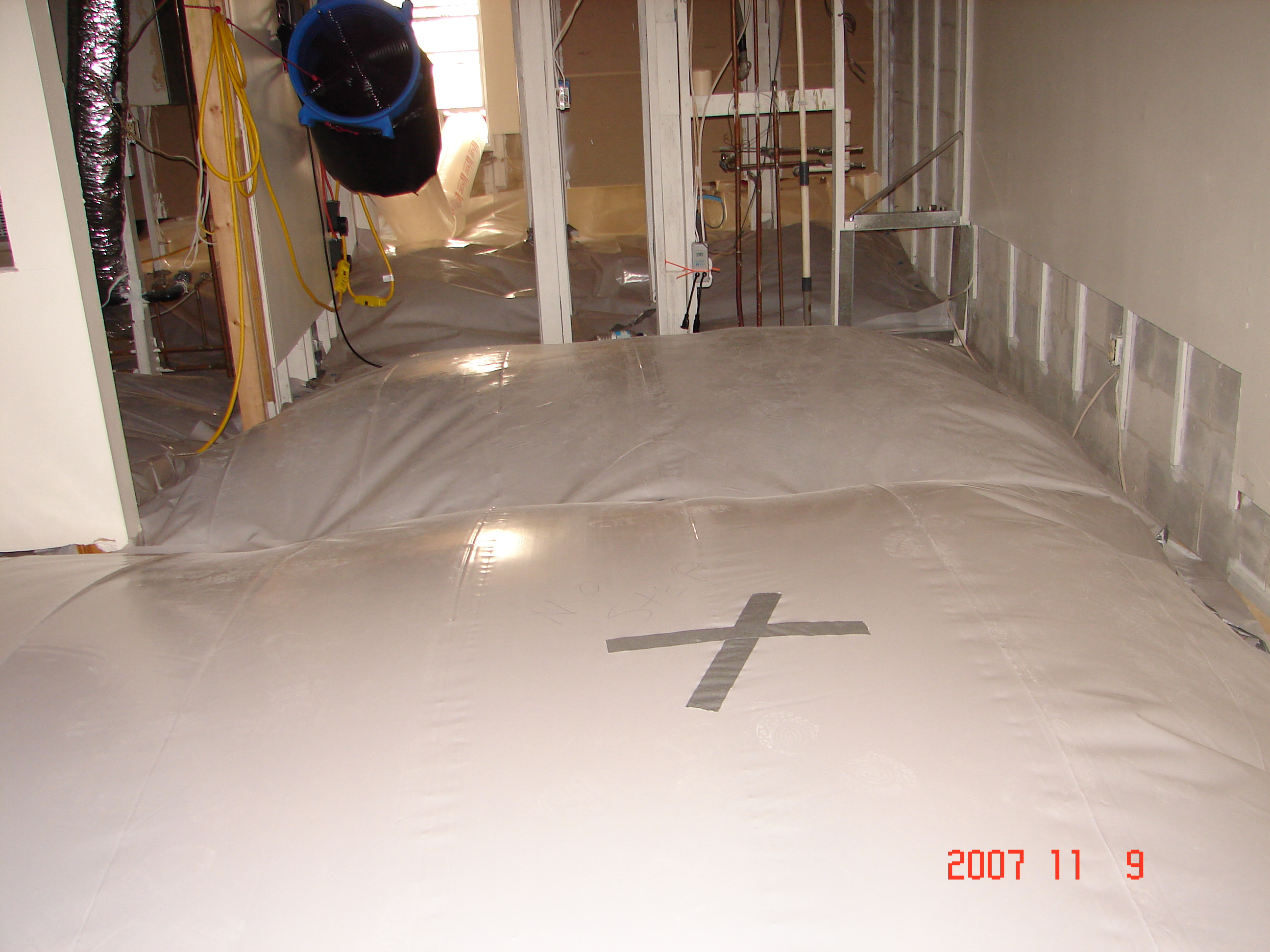 Photo of a particular area to be dried contained by plastic tenting